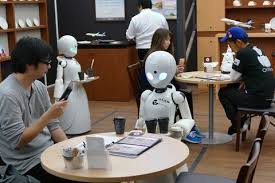 Photo of مقهى في اليابان يستخدم الروبوتات لخدمة الزبائن