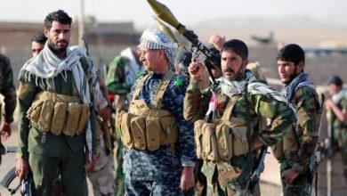 """Photo of تهديد العصابات """"المدعومة من إيران"""" في العراق بالرد على زيارة الرئيس الأميركي"""