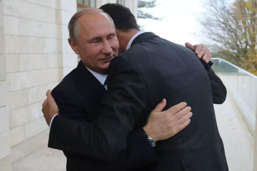 بشار الأسد وفلاديمير بوتين - أرشيف