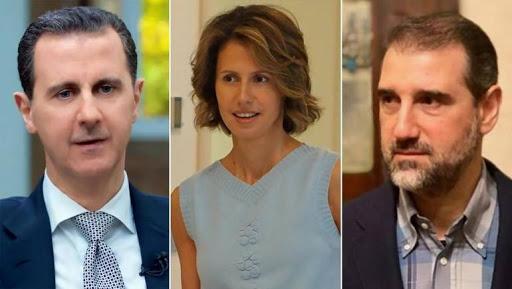 رامي مخلوف وبشار الأسد وأسماء الأسد - وكالات