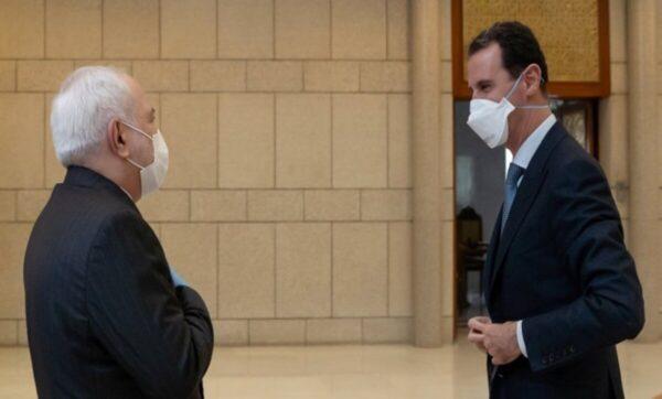 بشار الأسد ووزير الخارجية الإيراني - وكالات