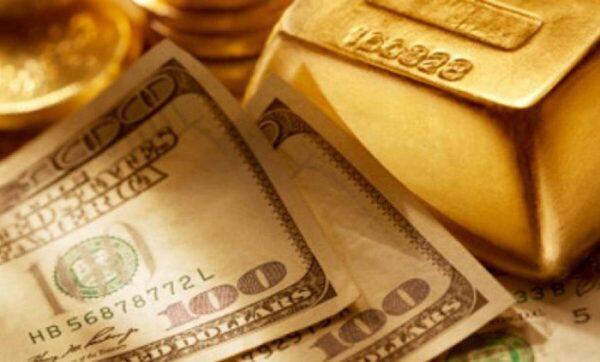 الذهب والدولار الأمريكي - تعبيرية
