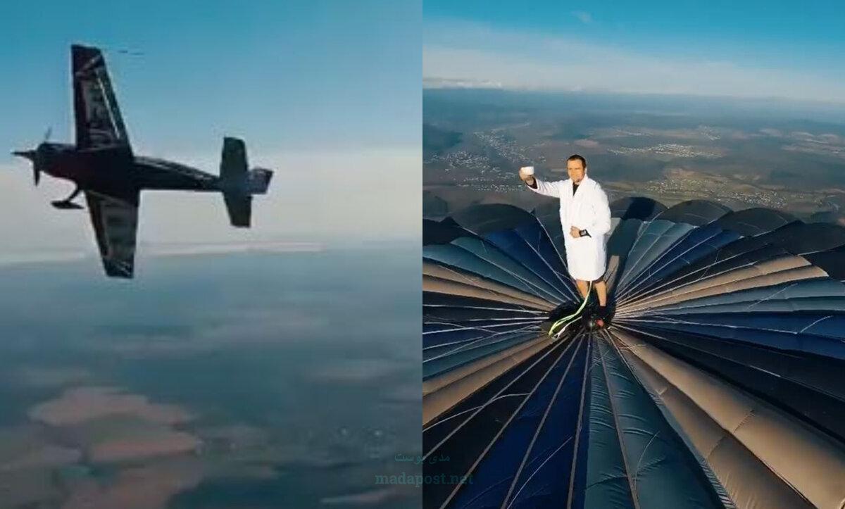 شاب يلقي التحية على طائرة من أعلى بالون ضخم