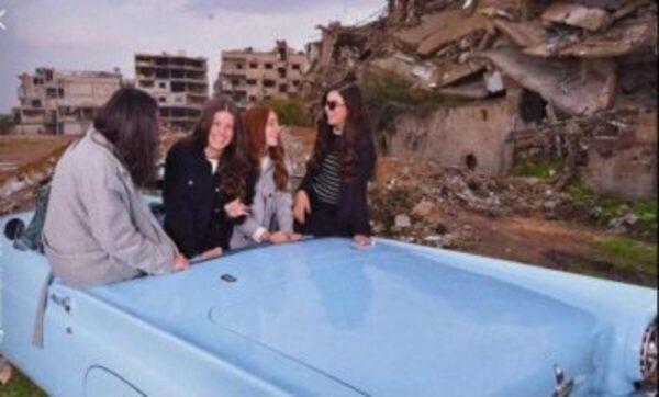 آية حمشو - الغوطة  ابنة محمد حمشو تتمايل فرحاً أمام منازل غوطة دمشق الشرقية (صور)