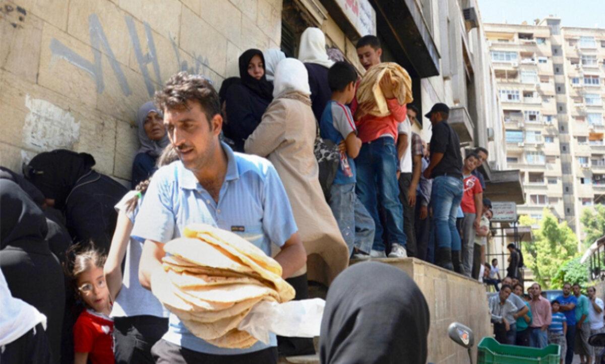 سوريون على طوابير الخبز - مواقع التواصل