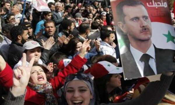 بينما تعم التظاهرات العالم دعماً للقدس.. موالون يتظاهرون لتأييد بشار الأسد (فيديو)