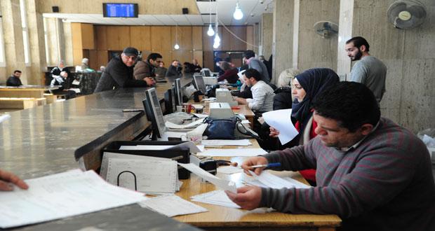 التجار والمغتربون في المقدمة.. نظام الأسد يضع يده على أموال السوريين في المصارف